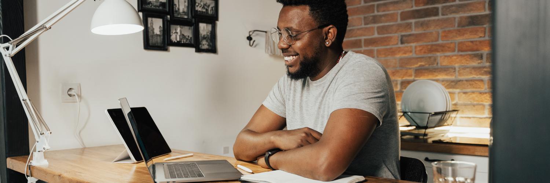black man learning a new language via laptop