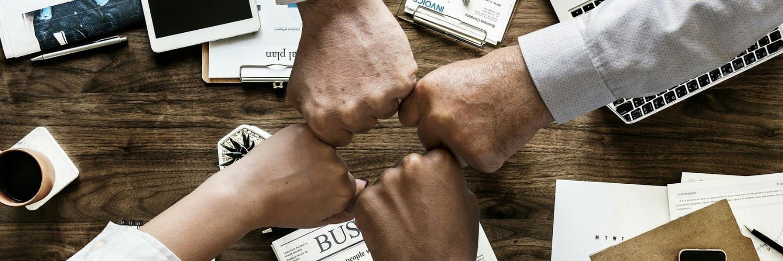 teamwork closed fists